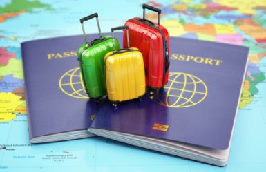 47274528 - travel or tourism concept. passport and suitcases on the world map. 3d